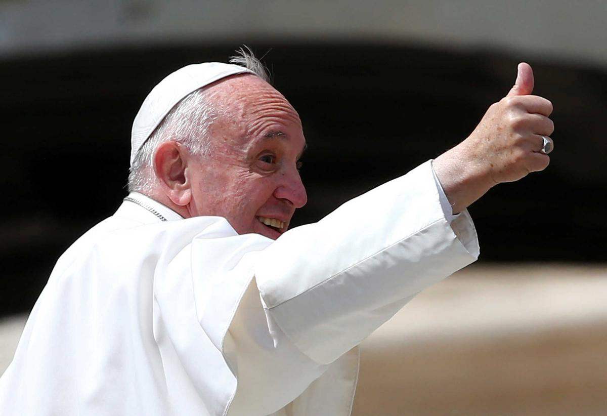 Pope Francis gestures as he leaves at the end of the Wednesday general audience in Saint Peter's square at the Vatican