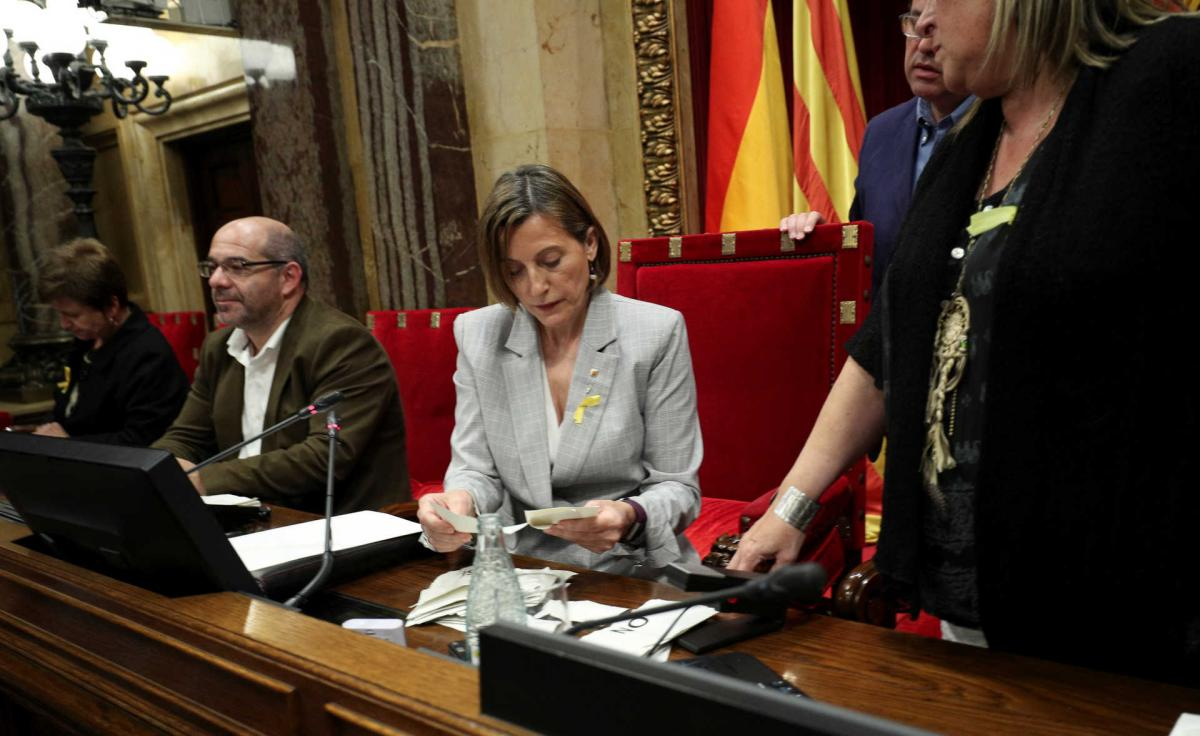 Speaker of the Catalan regional parliament Carme Forcadell counts ballots after a vote on independence from Spain at the  Catalan regional Parliament in Barcelona