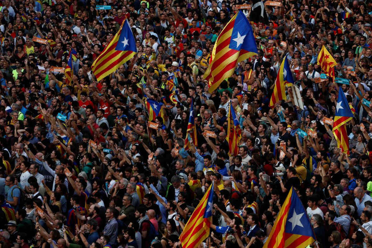 People wave Esteladas (Catalan separatist flags) and they gather at Sant Jaume square after Catalan regional parliament declares independence from Spain in Barcelona